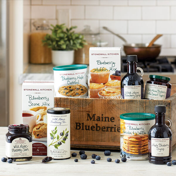 """This gift is like bringing in a real blueberry harvest! In fact, we packed nine of our sensational blueberry products within a wooden blueberry box that was used to harvest blueberries right here in Maine. Each box has built-in handles, is stackable and uniquely weathered with individual wear and tear from having actually """"worked"""" on a blueberry farm. They make great garden accessories, seasonal decorations, shelves or shadowboxes. This is a terrific gift that's sure to make someone """"blue"""" with envy!"""