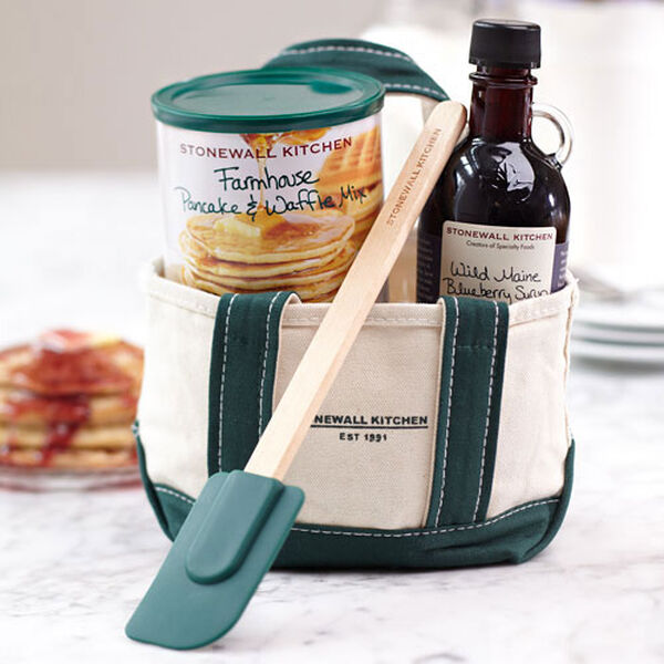 Inside this handsome mini canvas tote you'll find our Wild Maine Blueberry Syrup (8.5 oz.), a small Farmhouse Pancake & Waffle Mix and a medium forest green spatula. The tote is also embroidered with our Stonewall Kitchen logo.