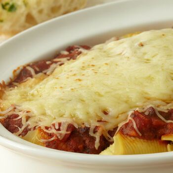 Vegetable Stuffed Shells topped with Olive Marinara Sauce