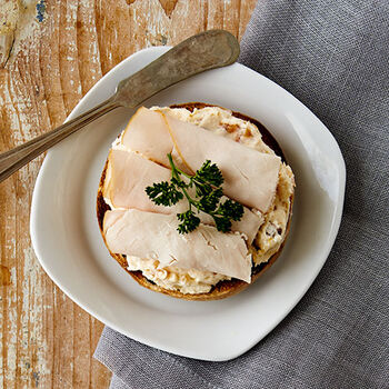 Chutney Cream Cheese topped with Smoked Turkey Breast Bagel